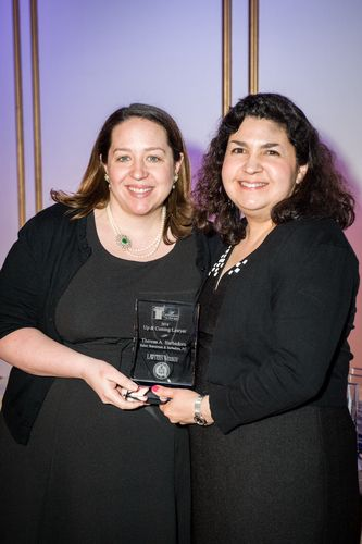 Theresa Barbadoro, of Baker, Braverman & Barbadoro, P.C., receives Excellence in the Law award from Massachusetts Lawyers Weekly Editor-in-Chief Susan Bocamazo.