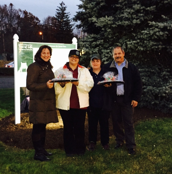 "(L to R) Janet Gallugi of the VNA stands with Between Rounds Bakery Sandwich Café's Michelle Harding, Assistant Manager, Kim Sears, Manager, and Jerry Puiia, co-owner during the ""The Tree of Life"" memorial Tree Lighting ceremony."