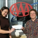 Krystal Brig, Branch Manager at AAA Southern New England in Plymouth presents Lucille Dallaire, Development Director at OCES, a donation towards OCES' Emergency Fund Program.