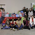 "The staff at VoiceNation donated 146 gifts in their ""Operation Give Back"" program that ensures local children living in shelters or in need of assistance receive gifts this holiday season."