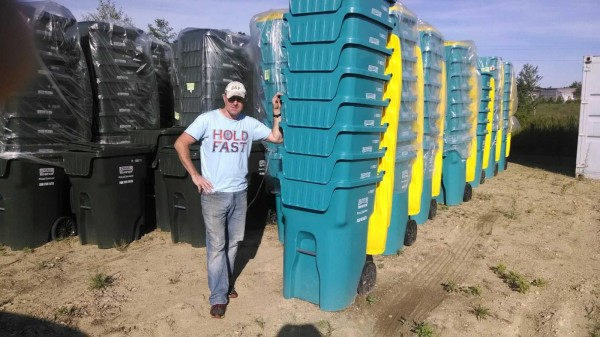 Matt Romboldi, owner of Lombard's Waste Service, with the teal recycle bins touting ovarian cancer awareness
