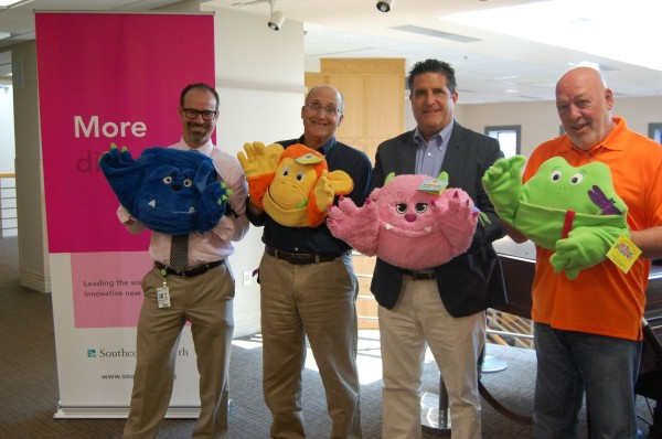 :  South Coast Improvement, Co. Vice-President Sean Whalen (third from left) recently donated 25 pillow puppets to the children at Southcoast Hospital's pediatric ward as part of their Radiothon 2014. Also pictured are (l-r) Dr. Brian Sard, Pete Braley and Jim Casey from Southcoast Hospitals.
