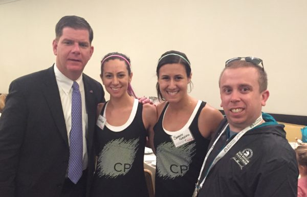 John Shea, producer at Talking Information Center reading service for the visually impaired (right) with Boston Mayor Martin Walsh and runners Sarah Dever and her sighted guide Sammie Nunziata of Team With A Vision during Massachusetts Association for the Blind and Visually Impaired Volunteer Appreciation Brunch.