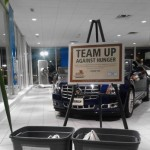 Tracy Chevrolet Cadillac puts it in drive. Plymouth automobile dealership teams up against hunger to support local food pantries