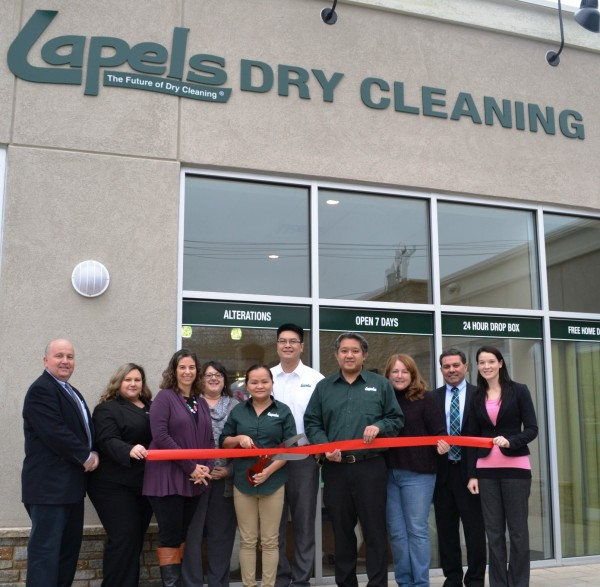 Lapels Dry Cleaning of Wakefield owners Kevin Dao, Kevin Dao, Lien Tang and Thanh Tran pose with members of the Wakefield-Lynnfield Chamber of Commerce. Lapels Dry Cleaning of Wakefield celebrated its grand opening on January 9.